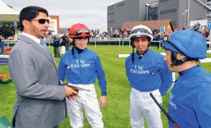 Godolphin trainer Saeed Bin Surour having a chat withchampion jockey Frankie Dettori and Ajtebi.